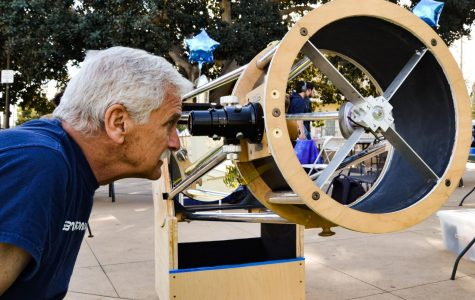 Former student and astronomy enthusiast Bob Smith looks at the Santa Ynez mountains behind Santa Barbara through the telescope the Astronomy Club built on Wednesday, Jan. 29, at the Friendship Plaza on East Campus at City College in Santa Barbara, Calif.