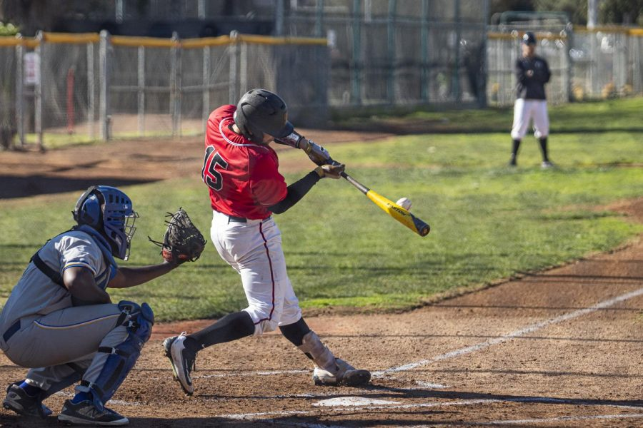Alonzo Rubalcaba (No.15) hits the ball down the middle and gets a single, on Saturday, Jan. 25, 2020, at Pershing Park, City College in Santa Barbara, Calif. City College beat West LA Community College 4-3.