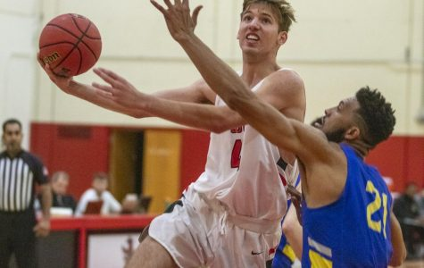 Calvin Winestock (No.42) goes for a layup against Sidney Bowen (No.21) on Wednesday, Jan. 22, 2020, in the Sports Pavilion at City College in Santa Barbara, Calif.