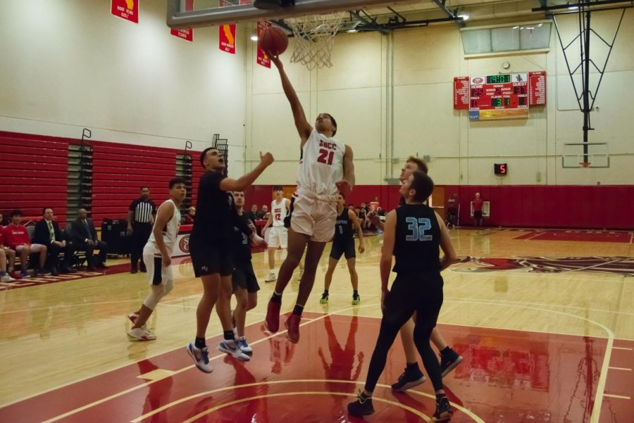 Adrian+Juilland-Johnson+%28No.+21%29+puts+up+a+lay-up+past+defenders+during+the+first+half+of+the+game+against+the+Moorpark+College+Raiders+in+the+Sports+Pavilion+Gym+on+Wednesday%2C+Jan.+29%2C+2020%2C+at+City+College+in+Santa+Barbara%2C+Calif.+The+Vaqueros+lost+the+game+to+the+Raiders+96-66.