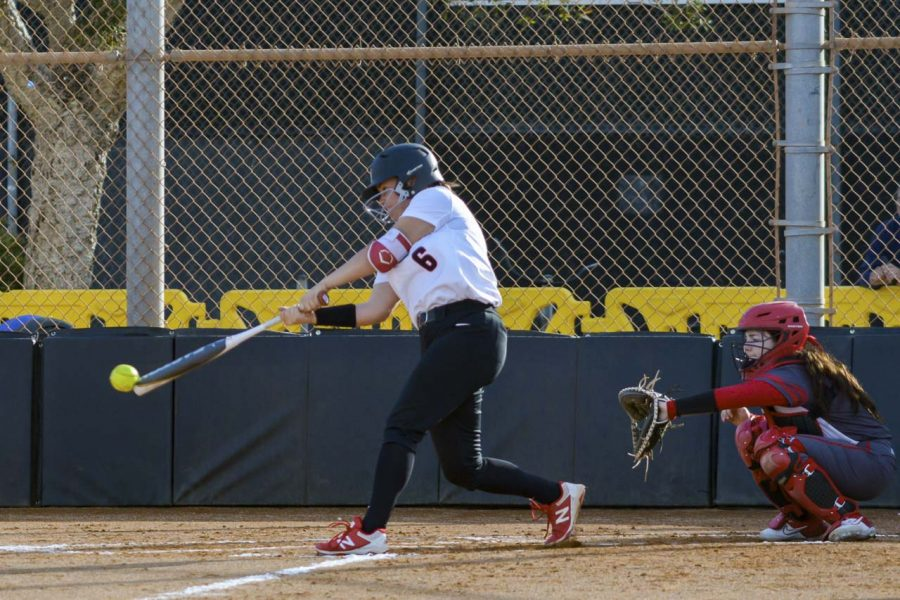 Paige Powell drives a ball down the right-field line during the third inning of the Vaqueros game against the Bakersfield College Renegades on Thursday, Jan. 30, at Pershing Park in Santa Barbara, Calif. The Vaqueros lost the game 13-5.
