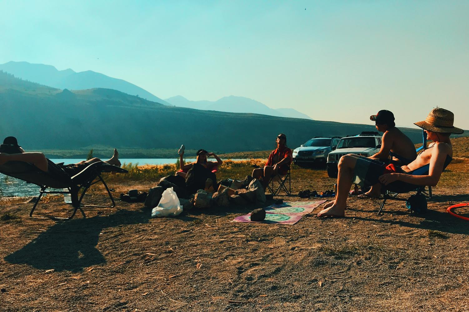 """Relaxing at a camp spot, locals call """"Rattlesnake Cove"""" at Grant Lake for a friends' birthday."""