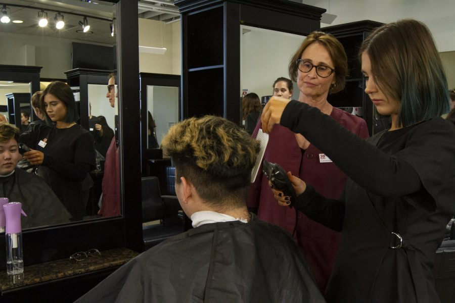 Head of the Cosmetology Academy Michelle Puailoa guides Alex Sugent in cutting fellow student Kenton Yamatake's hair on Feb. 5, 2020, at the City College Cosmetology Academy in Downtown Santa Barbara, Calif.