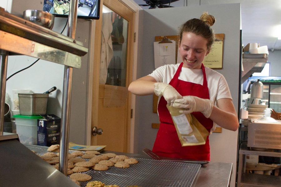 Siobhan Holden packages cookies to sell while chatting with her mom (not pictured) on Sunday, Feb. 2, 2020, in the shared kitchen of Santa Barbara Cookie Company and the Lemon & Coriander restaurant in Goleta, Calif.
