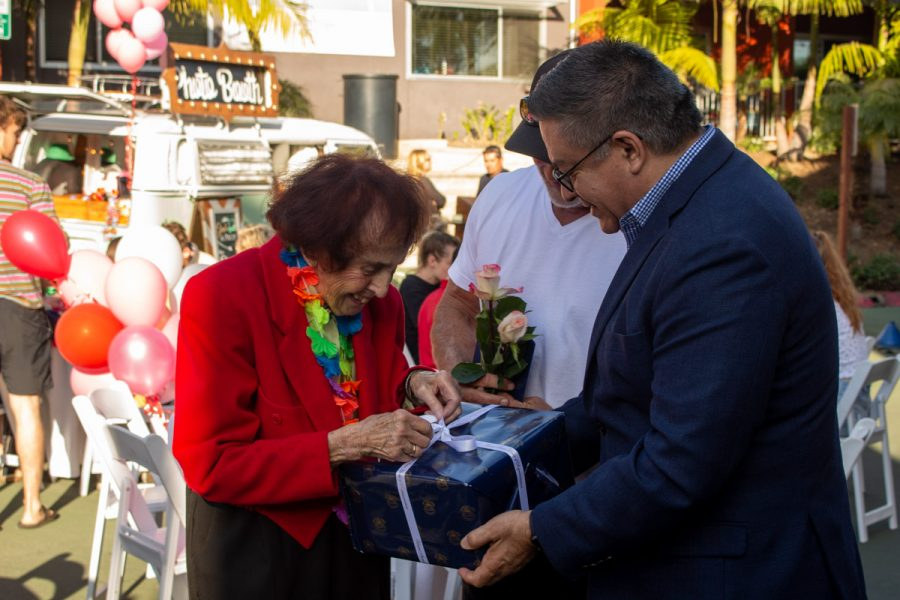 Rep. Salud Carbajal, D-Santa Barbara, along with Beach City's owner Ed. St. George presents Jean Nell with a birthday gift at Nell's Birthday party on Fri. Feb. 14 2020 at Beach City in Santa Barbara, Calif.
