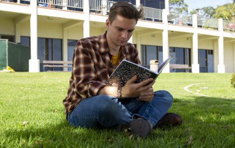 Jeremy Siegel Steffen writes poetry in a grassy patch next to the ECC building on Feb. 5, 2020, at City College in Santa Barbara, Calif. Steffen writes poems here during his free time between classes or working at The Well.