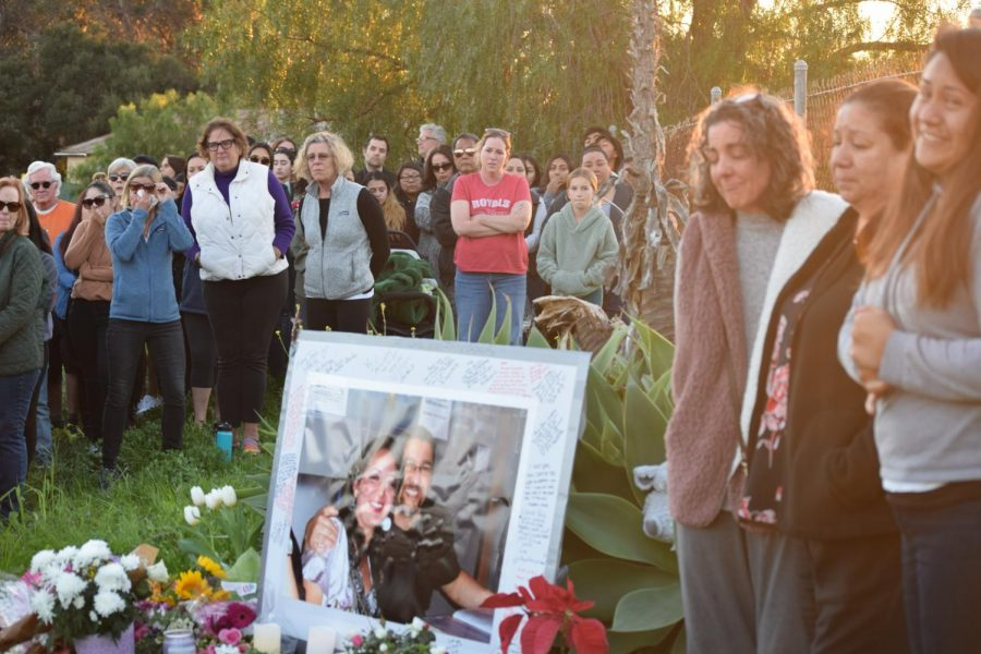 Friends, family and community members share memories and prayers at a memorial for Mary-Jane and Adolfo Corral on Cathedral Oaks Road on Monday, Feb. 10 in Goleta, Calif.