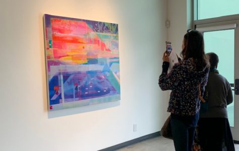 "City College student Patricia Kaneb, photographs and admires ""Prism and Lens"" by Zoe Walsh on Friday, Feb. 21, 2020 in the Atkinson Gallery at City College in Santa Barbara, Calif."