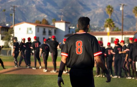 Kyle Froemke takes the field to congratulate his teammates after the Vaqueros beat Oxnard City College 10-1 on Thursday, Feb. 20 at Pershing Park in Santa Barbara, Calif. The baseball team's season has now been suspended after a vote by the CCCAA, along with all other spring sports.