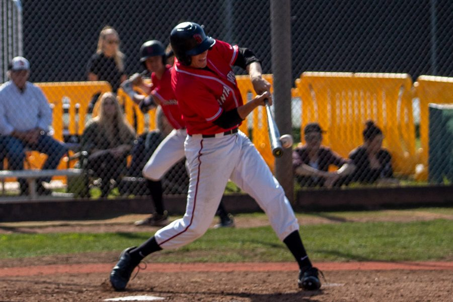 Toby Spach (No.17) hits the ball and gets a single on Saturday, Feb. 15, 2020, at Pershing Park at City College, in Santa Barbara, Calif. The Vaqueros beat Cerro Coso Community College 8-1.