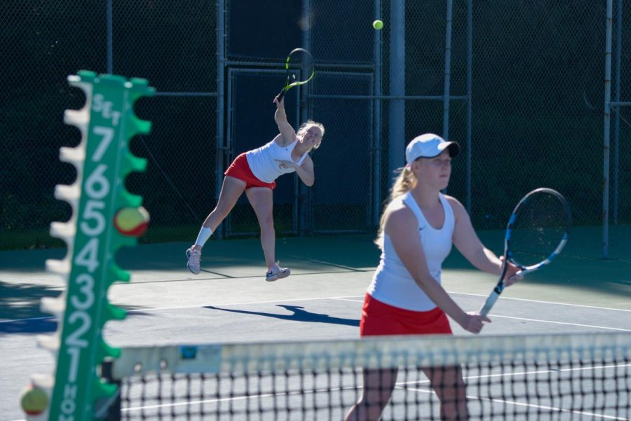 Joica Buyse serves the ball as her sister Jamaica Buyse waits at the net during a doubles match against Santa Monica College Corsairs at Pershing Park on Tuesday, Feb. 11, 2020 in Santa Barbara, Calif. The Buyse twins won their match 8-1 and the Vaqueros swept the Corsairs 9-0.