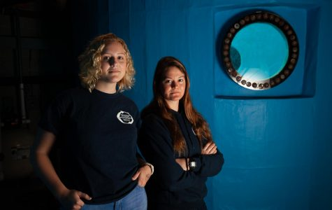 From left, Kayla Hatfield and Emma Horanic stand beside a dive tank used to practice underwater pipe cutting on Tuesday, Feb. 4 2020, in the basement of the Marine Diving Technology Building at City College in Santa Barbara, Calif. Horanic and Hatfield are the only female students in the MDT program at City College.