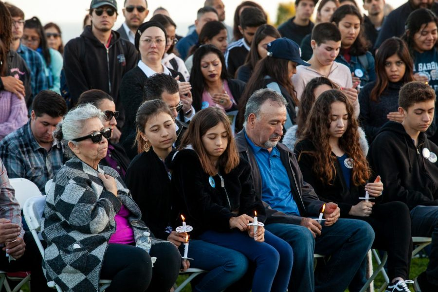 Adolfo and Mary-Jane Becerra Corrals' four children sit in the front row holding candles for the Vigil remembering their parents on Wednesday, Feb. 12, on the West Campus Lawn at City College in Santa Barbara, Calif. Several hundred people gathered to honor the Corrals and listen to family, friends and co-workers speak.