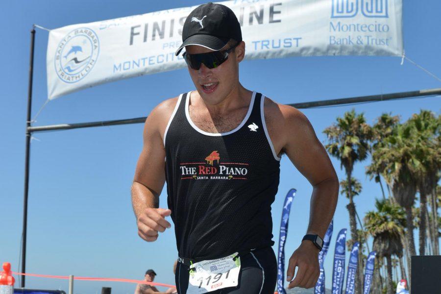 Connor+Newsum+crosses+the+2019+Santa+Barbara+Triathlon+finish+line+Aug.+24%2C+2019+in+Santa+Barbara%2C+Calif.