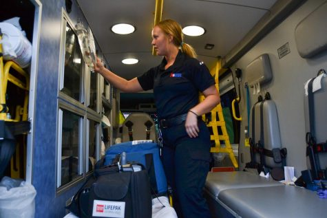 "Tia Taylor checks emergency equipment in an ambulance before her night shift on Thursday, March, 12, 2020, at the American Medical Response Station in Goleta, Calif. ""We will be expecting a lot of calls regarding the Coronavirus,"" Taylor said. ""Making sure we are prepared is crucial."""