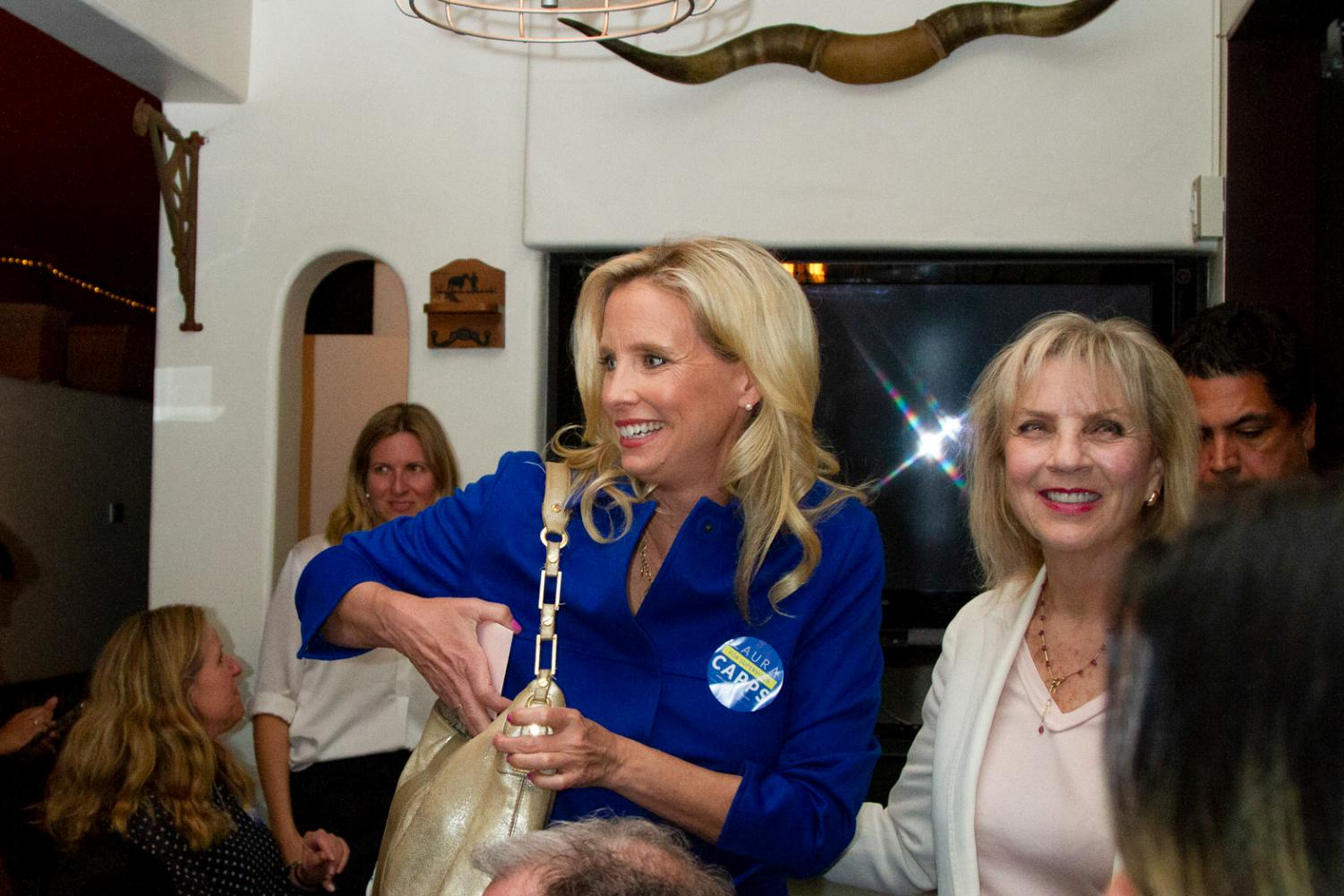Laura Capps similes while entering her joint election party with Elsa Granados on Tuesday, March 3, 2020 at Jill's Place Restaurant in Downtown Santa Barbara, Calif. Laura said that she can be optimistic and positive about her campaign because they were able to communicate with voters.