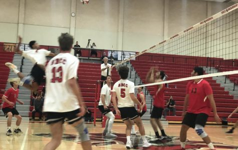 Keoni Thiim, six kills, goes up for a spike during the first set of City College's sweep of Pierce College men's volleyball.