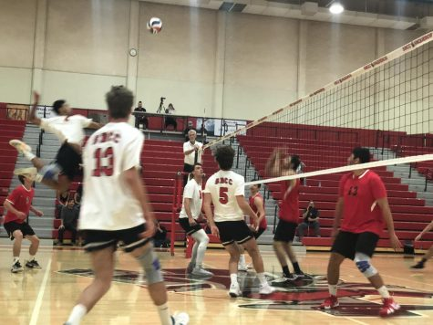 Keoni Thiim, six kills, goes up for a spike during the first set of City College