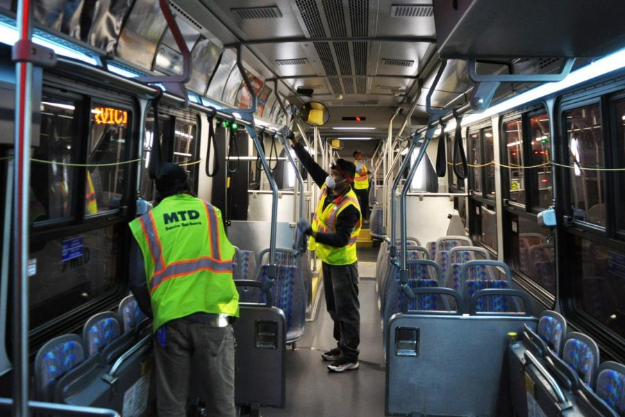MTD workers clean and disinfect a city bus after hours. An additional team has been brought in to aid with the sterilization. Photo courtesy of Hillary Blackerby, MTD.