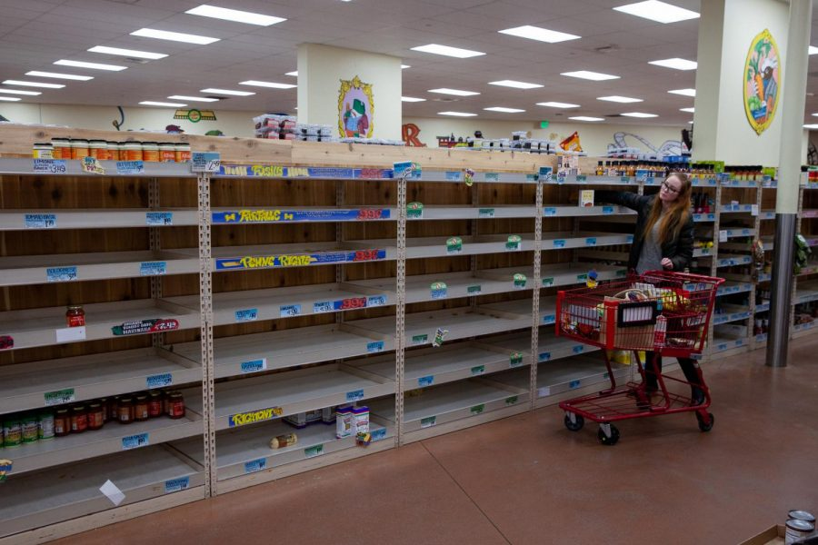 As shoppers stock up for social distancing, grocery stores like Trader Joe's struggle to keep items like non-perishables, cleaning supplies and toilet paper on the shelves on Friday, March 13, 2020 at Trader Joe's on N Milpas Street in Santa Barbara, Calif.