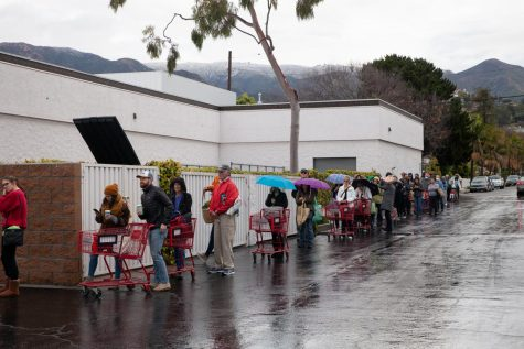 Shoppers line up around Trader Joes's to prepare for social distancing as the grocery chain limits the capacity of shoppers from 10-25 at a time on Tuesday morning, March 17, 2020, at Trader Joe's on N Milpas Street in Santa Barbara, Calif.