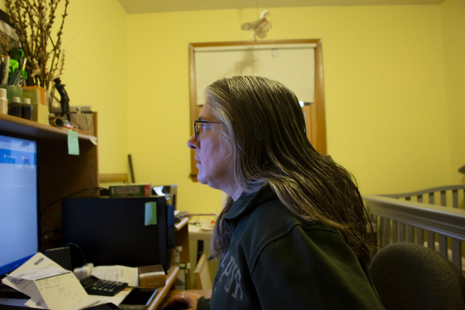 Terese Brunner works on filling out unemployment forms after losing her jobs due to the shelter in place order on April 6, 2020, at her home in New Holstein, Wis. Two out of her three jobs have already asked her to come back when it is safe to do so.