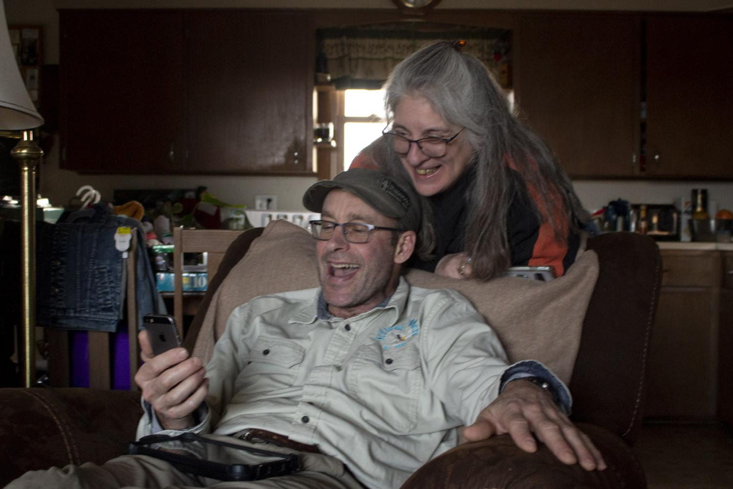 Mitch Schrage and Terese Brunner laugh with their 3 year-old grandson Oscar over facetime on April 10, at their home in New Holstein, Wis. Both Schrage and Brunner are sad that they're unable to babysit Oscar or see him in person, but they're thankful to see him through video chat.