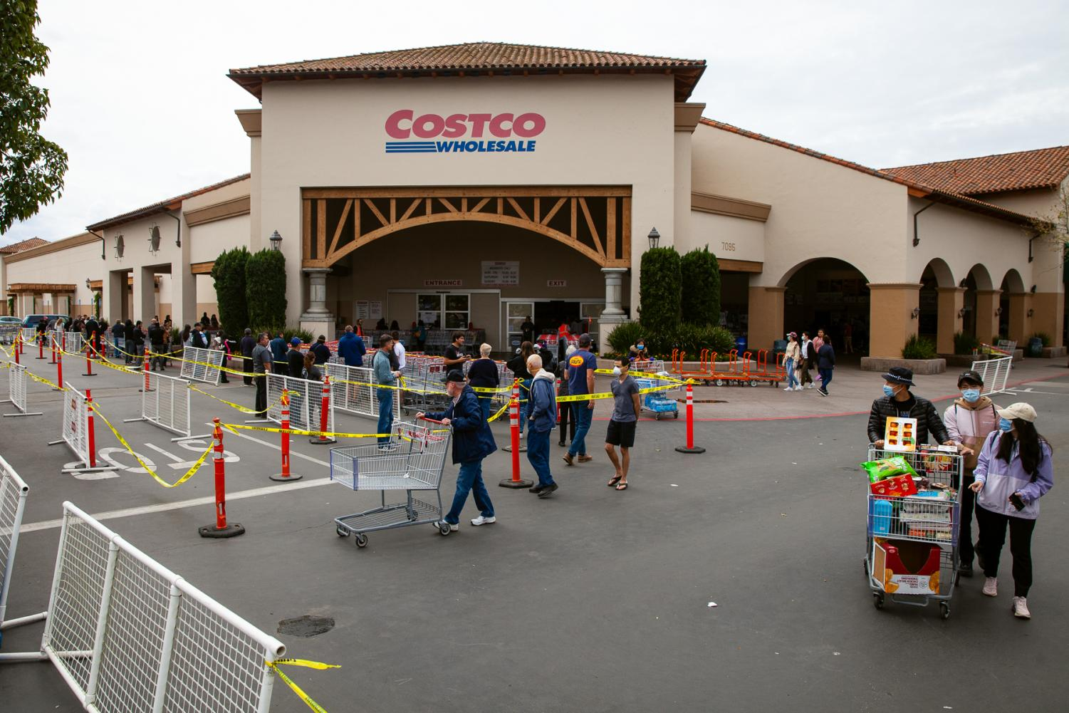 Shoppers lineup outside Costco the morning after Gavin Newsom issued a state wide shelter-in-place order on Friday, March 20, in Goleta, Calif. Costco limits its capacity to 50 shoppers at a time.