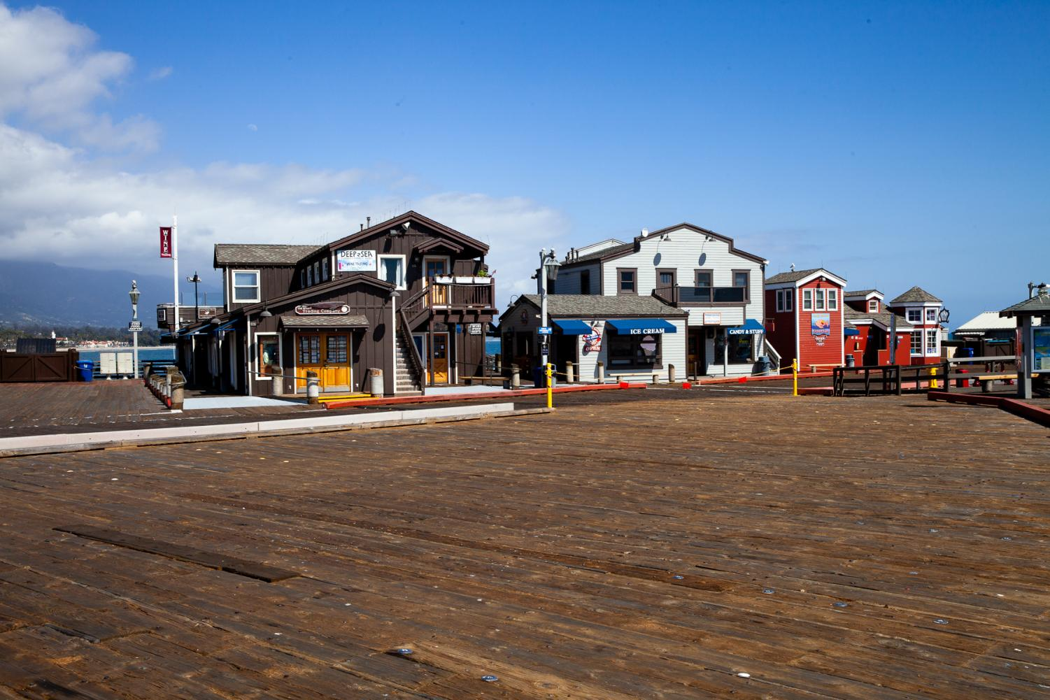 Restaurants and shops on Stearns Wharf remain open but see little traffic as shelter-in-place measures continue through April.