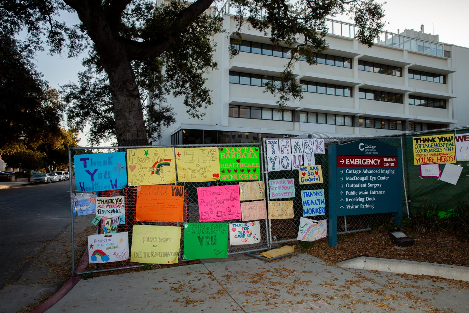 A collection of posters thanking medical workers decorate a construction fence surrounding the eastern quarter of Cottage Hospital in Santa Barbara, Calif.