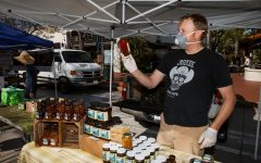Owner of Blue Ridge Honey Greg Mitchell has seen sales go up as the local farmers market has remained open throughout the state-wide business closures on Tuesday April 21, 2020 in Downtown Santa Barbara, Calif.