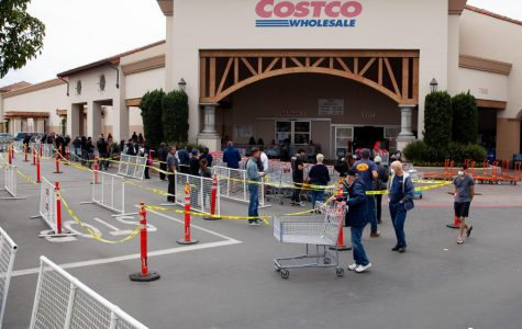 Shoppers lineup outside Costco the morning after California Gov. Gavin Newsom issued a statewide shelter-in-place order on Friday, March 20, in Goleta, Calif. Costco limits its capacity to 50 shoppers at a time.
