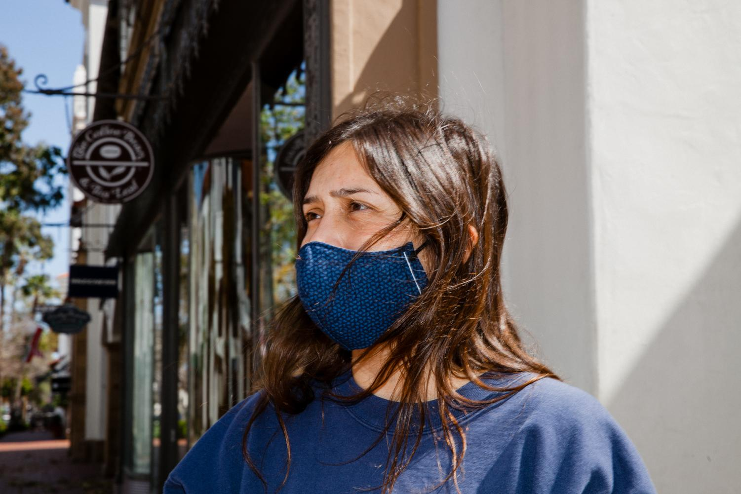 Lizeth Losa bought her mask from a boy on the street selling face coverings for four dollars. Monday, April 20 in Downtown Santa Barbara, Calif.