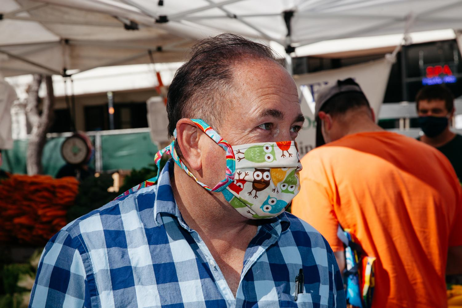 Micheal Amador in a handmade mask from a friend on Tuesday, April 21 in Downtown Santa Barbara, Calif.