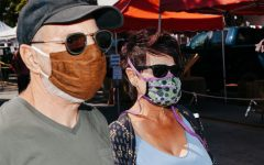 Peter and Naomi Pavia in homemade masks stitched by Naomi on Tuesday, April 21 in Downtown Santa Barbara, Calif. Naomi Stitches masks to donate to friends, neighbors and nursing homes while Peter thinks the virus is exaggerated, but wears a mask to be courteous to others.