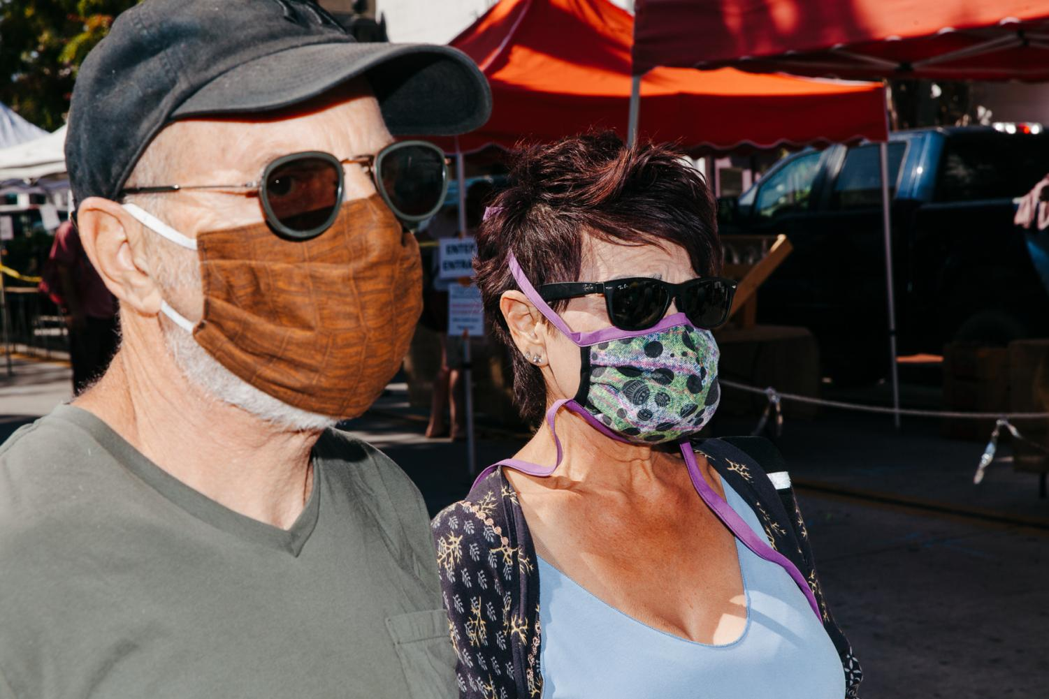 Peter and Naomi Pavia in homemade masks stitched by Naomi on Tuesday, April 24 in Downtown Santa Barbara, Calif. Naomi Stitches masks to donate to friends, neighbors and nursing homes while Peter thinks the virus is exaggerated, but wears a mask to be courteous to others.