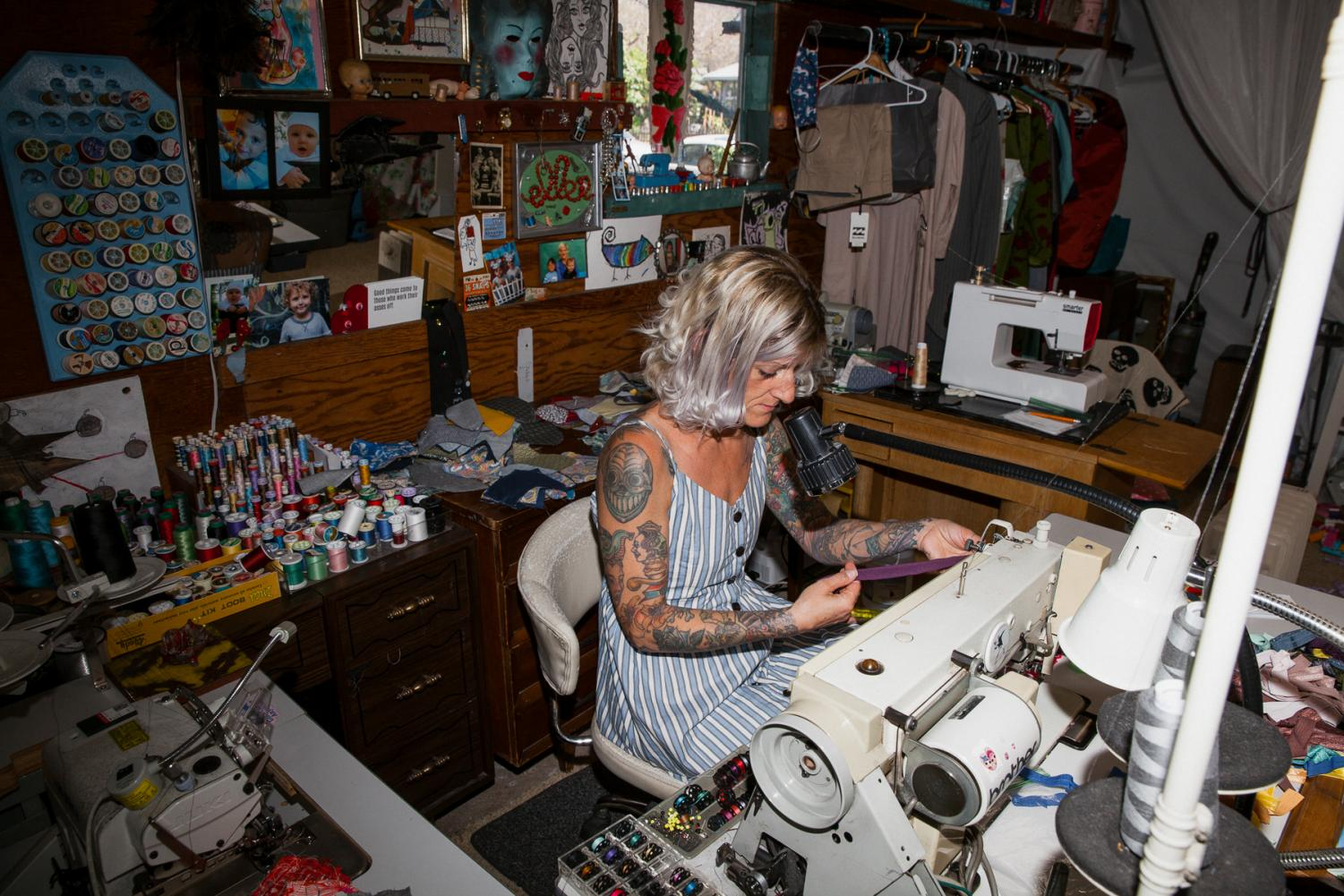 Ellen Beebe-Sztuck stitches face masks in her home workshop on Friday, April 24 behind her home in Downtown Santa Barbara, Calif. Beebe-Sztuck has recently shifted focus of her sewing and alteration business Stitch Witch to face coverings as the demand for masks steepens.