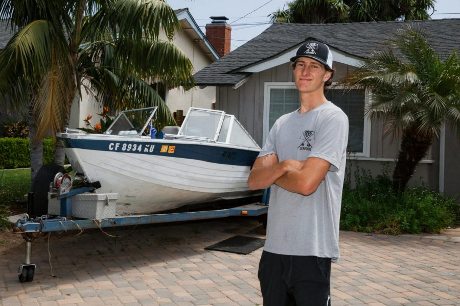 Connor Streett started his business 805 Seafood as a fish vendor at 17 years old and is grateful for customers still buying local fresh fish during the pandemic in front of his home and fishing boat on Thursday, April 30, 2020 in Santa Barbara, Calif.