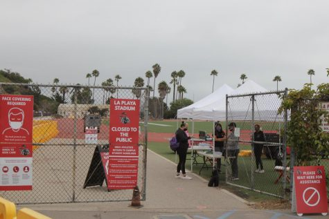 City College Student checks in before the first day of Physical Education classes on Monday, Aug. 31 at La Playa Stadium in Santa Barbara, Calif. All students and staff must complete a health survey before being allowed to participate in on-campus activities.