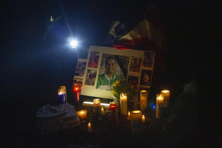A memorial put together in Nicholas Claudio's honor for his vigil on Oct. 3 at Sands Beach in Isla Vista, Calif. Claudio's close friends placed items that reminded them of him like pizza, candles with messages written on them, flowers and alcohol.