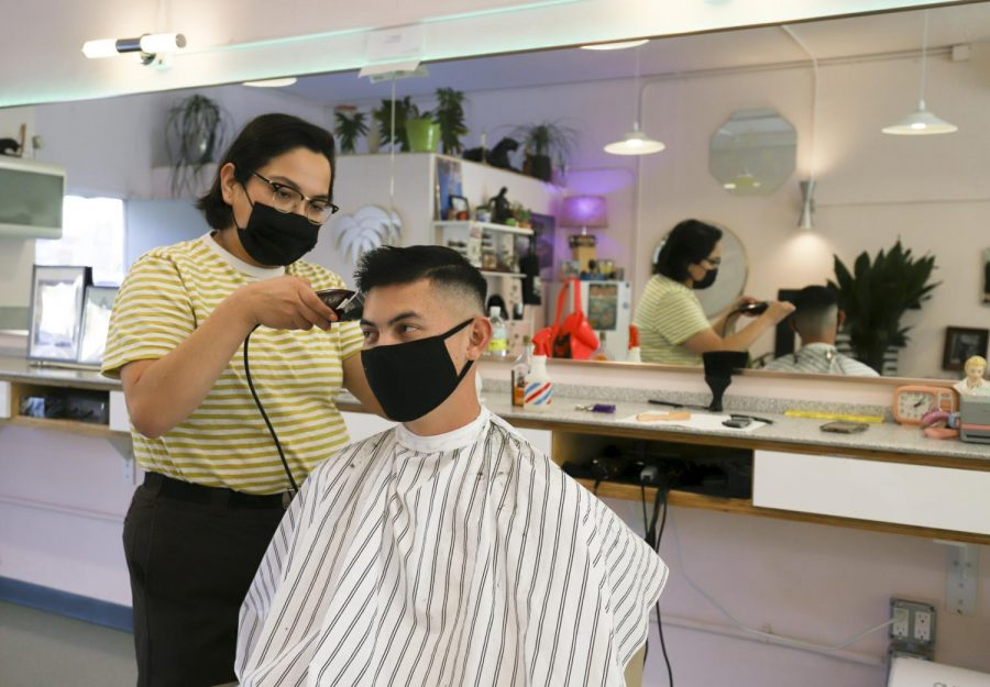 "Erin Guereña trims up long-time returning client Tyler Silvestre's hair on Nov. 19, 2020 at Haven Barber Shop at 1924 De La Vina St. in Santa Barbara, Calif. ""I don't even need to look at it,"" Silvestre said to Guereña. ""Your hair cuts are perfect every time."""