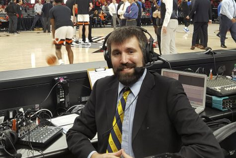 Eric Evelhoch courtside after broadcasting UCSB women