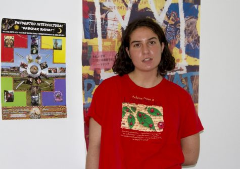 Ili Levine stands in her home next to a picture from the traditional ceremony she participated in during her trip to Ecuador, on Nov. 4, 2020, in Santa Barbara, Calif. Levin started her non-profit Ayudantes International after a trip to Ecuador last year where she witnessed how many people could not afford to feed their families for the day.