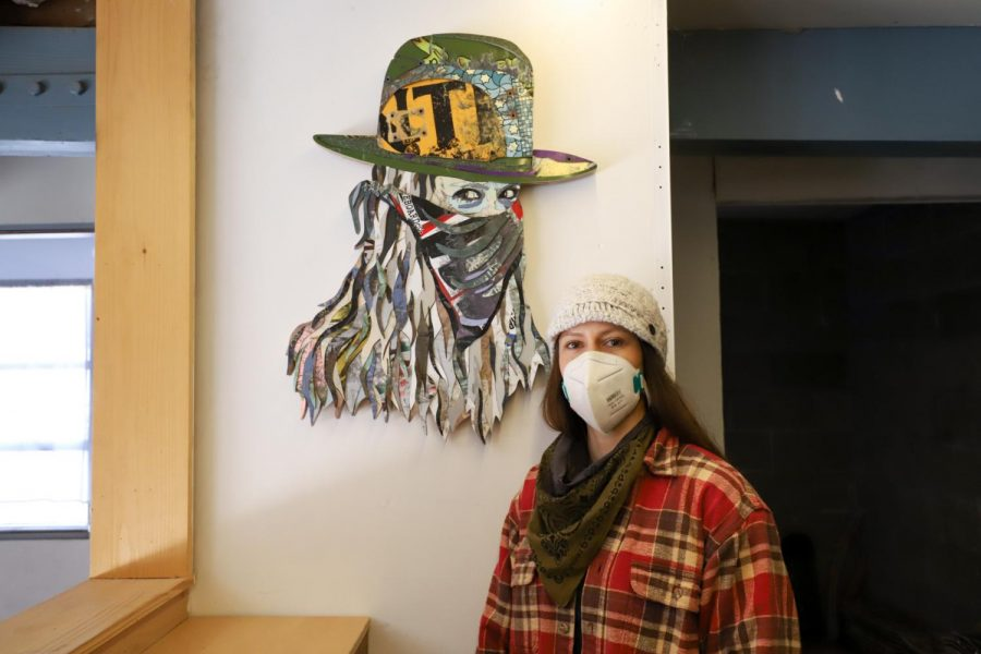 "Inga Guzyte next to her self portrait titled ""Super Rebel - Me"" on Nov. 30 at her studio in Santa Barbara, Calif. When Guzyte first came to City College she was unaware that being an artist could be a career choice. Now years later, she makes a living and an impact with her art."