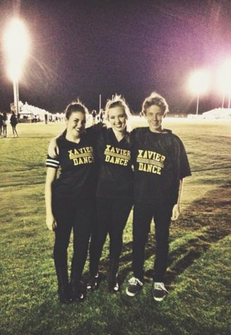 From right to left, Jacob Frank after a performance with sisters Jordan and Jaycie Frank on Sept. 27, 2013, at Xavier College Preparatory High School in Palm Desert, Calif. Jacob and his sisters had been dancing together for over five years, and just performed at a Xavier football game.