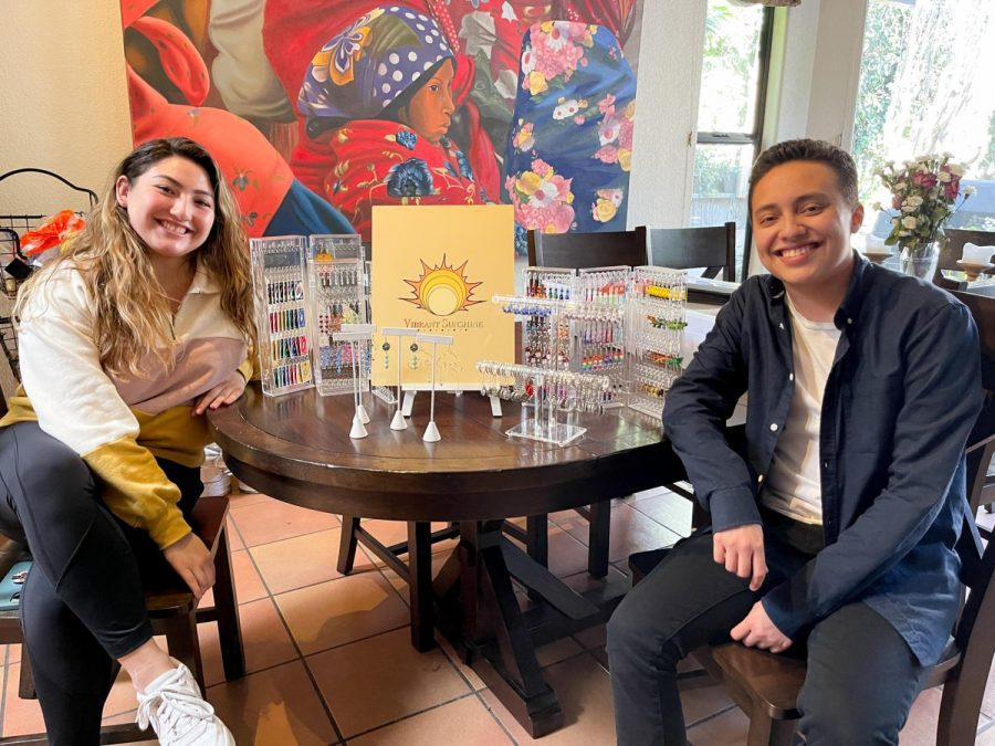 Solé Machart (left), and her boyfriend Mateo Ochoa with the inventory from Machart's jewelry business Vibrant Sunshine on Feb. 18, 2021 from Machart's home in Santa Barbara, Calif. Machart started making jewelry for fun and now sells her unique handmade jewelry on her Etsy shop.