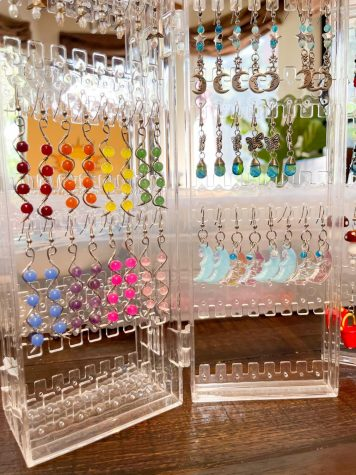 Five of Solé Machart's unique earring designs from her small business Vibrant Sunshine.