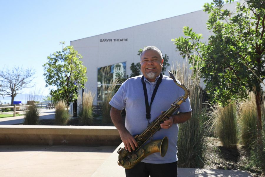 Jazz instructor Andrew Martinez with his saxophone outside the Garvin Theater on Feb. 23, 2021, at City College in Santa Barbara, Calif. Martinez first started playing the saxophone when he was in 8th grade and has never put it down since.