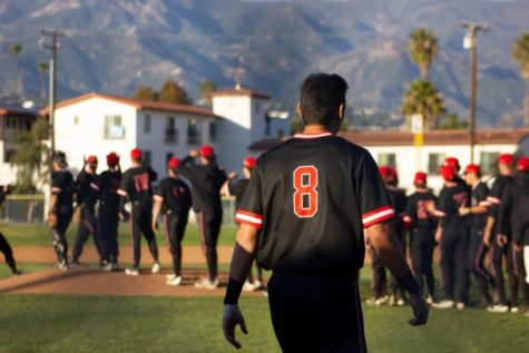 Kyle Froemke walks off the field after one of the City College baseball team