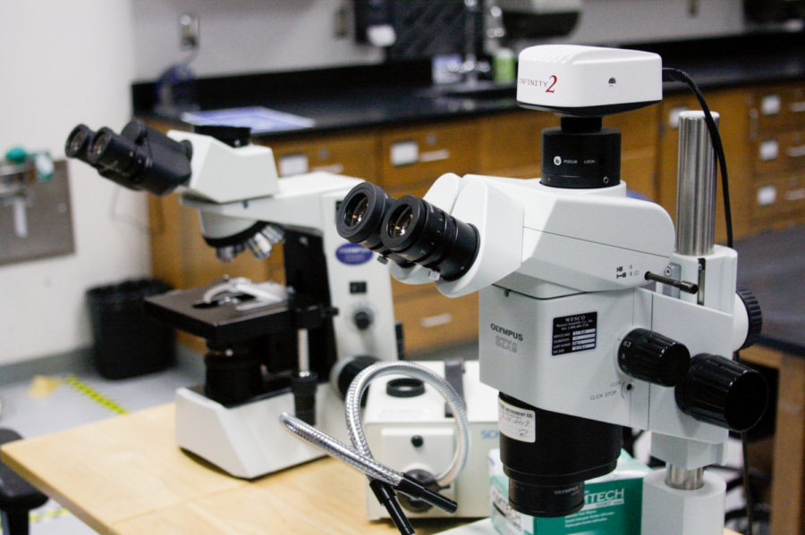 Two microscopes sit at the front of a classroom in the Earth and Biological Sciences building on April, 26 at City College in Santa Barbara, Calif. The camera on the top of the right microscope allows teachers to show students what they're seeing, but the quality of the cameras has diminished over the years.